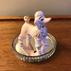 Small Vintage ceramic Poodle  on a round mirror.